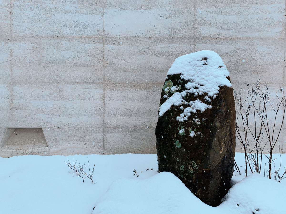 a rammed earth wall in the snow